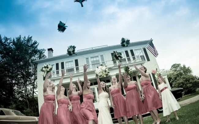 bridesmaids throwing bouquets